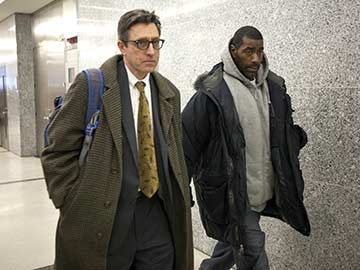 Kahton Anderson's Father with his son's lawyer (Photo from Michael Nagle/NYTimes)