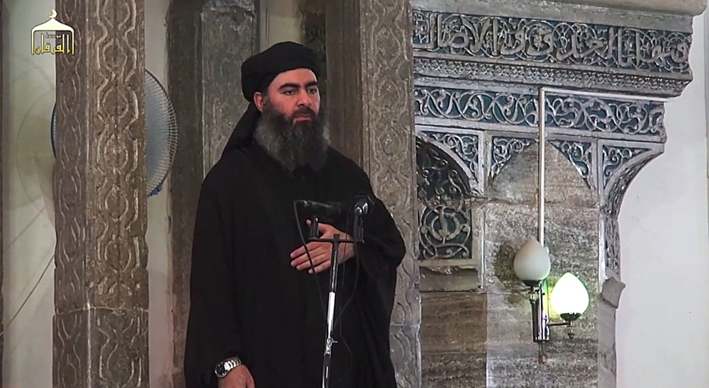 The leader of the militant Islamic State Abu Bakr al-Baghdadi has made what would be his first public appearance at a mosque in the centre of Iraq's second city, Mosul, according to a video recording posted on the Internet on July 5, 2014, in this still image taken from video. There had previously been reports on social media that Abu Bakr al-Baghdadi would make his first public appearance since his Islamic State in Iraq and the Levant (ISIS) changed its name to the Islamic State and declared him caliph. The Iraqi government denied that the video, which carried Friday's date, was credible. It was also not possible to immediately confirm the authenticity of the recording or the date when it was made.05/07/2014 IRAQ-MOSUL /AY-COLLECTION_1445.09/Credit:AY-COLLECTION/SIPA/1407061450 (Sipa via AP Images)